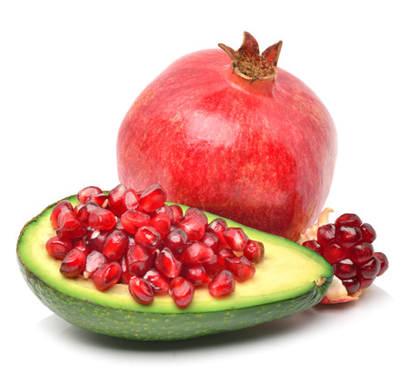 Ripe avocado and pomegranate isolated on white photo