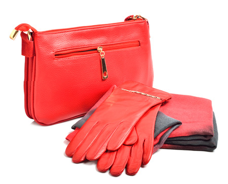 Stylish woman red bag, gloves and a scarf isolated on white background photo