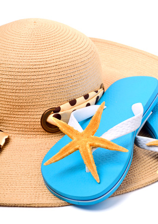 Beach hat, flip flops and starfish isolated on white photo