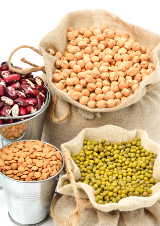 chick-pea, mung beans, kidney-beans in the sacks isolated on white photo