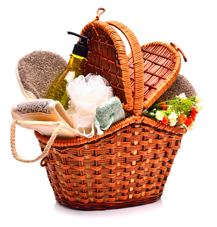 bast: Natural bath sponges, pumice, gel and flowers in the basket isolated on white