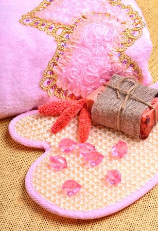 scrubber: pink bath towel, natural soap, body scrubber Stock Photo