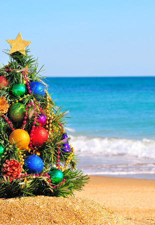 new year tree: Christmas tree on the sand in the beach Stock Photo