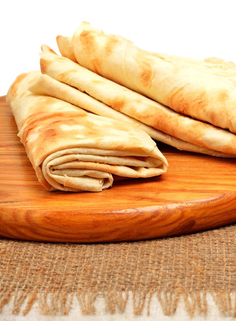 Lavash, tortilla wrap Bread on the cutting board isolated on white photo