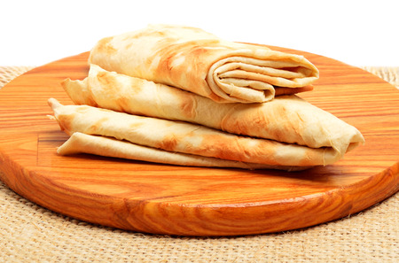 tortilla wrap: Lavash, tortilla wrap Bread on the cutting board isolated on white
