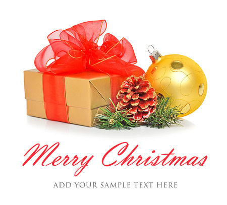 Gift box with red mesh bow, christmas bauble and cone isolated on the white background photo