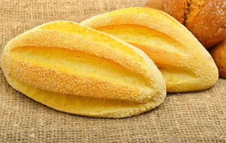 sacking: Fresh wheat buns on the sacking background.
