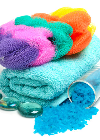 mops: Blue bath salt with towels, mops isolated on white background