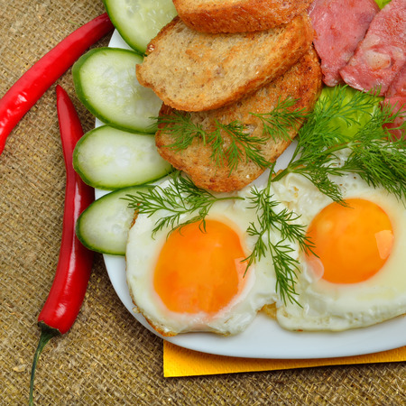 english cucumber: English breakfast - toast, egg, bacon and vegetables. Salad, cucumber. Stock Photo