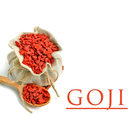 lycii: Goji berries in the sack bag with wooden spoon isolated on white
