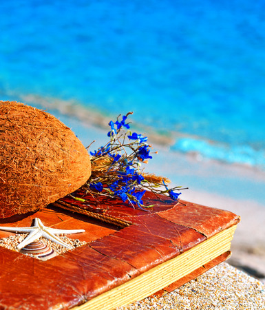 scrapbook homemade: Vintage album on the sand with coconut shell and flowers
