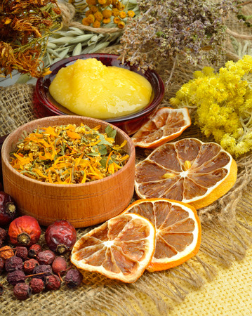 wild oats: Calendula flower, oats, immortelle flower, tansy herb, honey, wild rose, dried lemon on sacking background