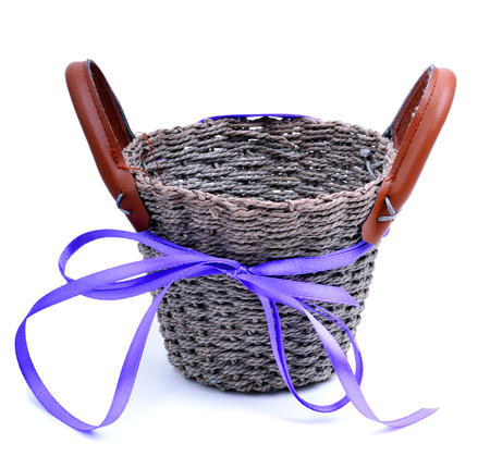homeware: Wicker basket with a straw isolated on white Stock Photo
