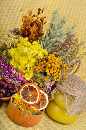 medicinal herbs: Medicinal herbs with honey, calendula, oats, immortelle flower, tansy herb, wild rose, dried lemon