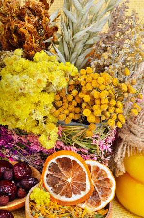 medicinal herbs: Medicinal herbs with honey, calendula, oats, immortelle flower, tansy herb, wild rose, dried lemon.