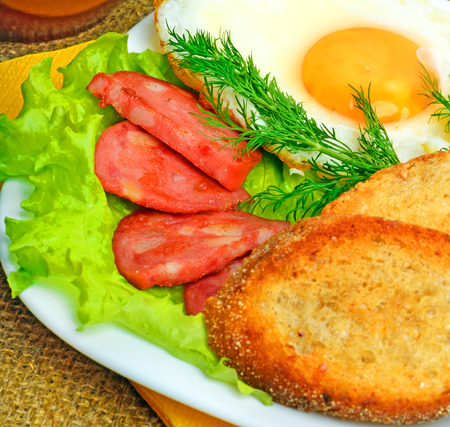 english breakfast: English breakfast, scrambled eggs with toasts, bacon, ham and vegetamles Stock Photo