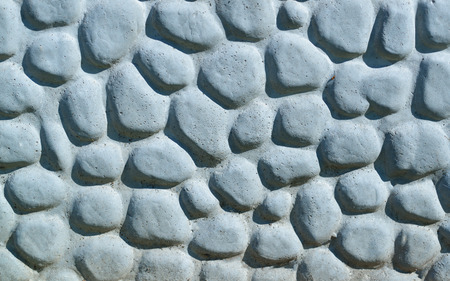 pebblestone: Background made of a closeup of a wall with pebbles