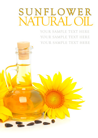 cooking ingredients: Carafe with vegetable oil and sunflowers isolated on the white background