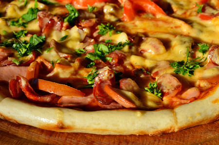 Tasty pizza with sausage and vegetables, macro view photo