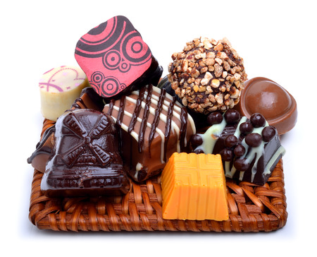 Assortment of various chocolate sweets  isolated on white photo