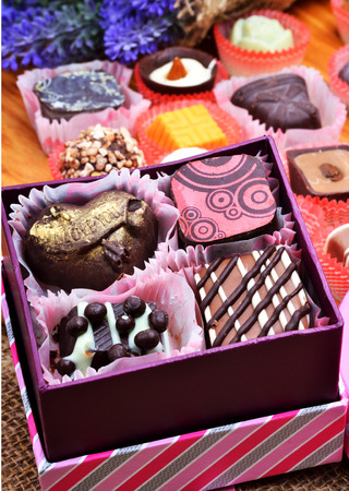 Assortment of chocolate sweets in gift boxes photo