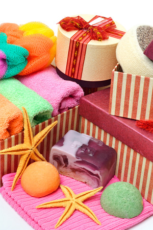 natural soap: Stack of towels, natural soap, gift boxes, salt bombs, starfishes isolated on white Stock Photo