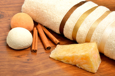 natural soap: Natural soap, bath towel, bath bombs on the wooden background Stock Photo
