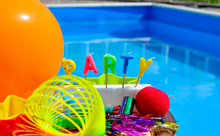 event party festive: Party decorations on the swimming pool background