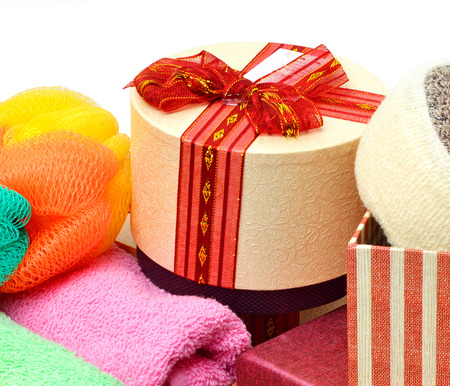 natural soap: Stack of towels, natural soap, gift boxes isolated on white Stock Photo