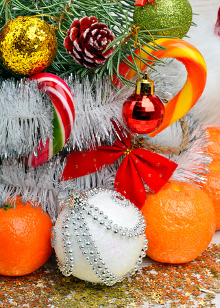 tree decorations: Christmas decoration, christmas baubles, pinetree and ripe tangerines. Stock Photo