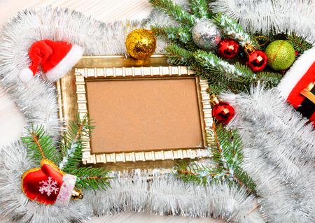 gir: Magic christmas decoration with frame, pine twigs, christmas baubles, Santas hat Stock Photo