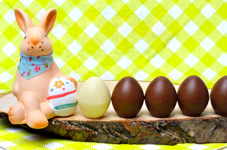 chocolate eggs: Easter decoration chocolate eggs and bunny on the burlap background. Stock Photo