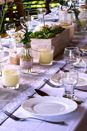 in the open air: Table setting at wedding reception  in the open air.