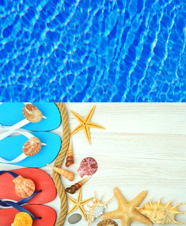 liquid reflect: Flip-flops, starfish and seashells on a wooden background.