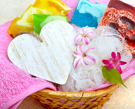 neatness: Handmade soap with flowers on a background colored towels.