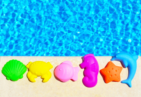 children crab: Baby Toys on the blue pool background.