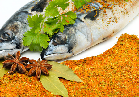 Mackerels with spices, parsley and bay leaf.