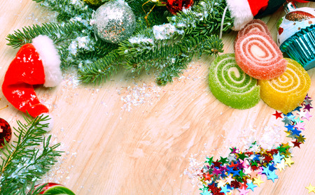 tinsel: Christmas background, lollipops, pine twig, sweets, jellies