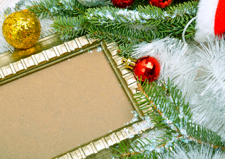 Christmas background. Frame, twig pine with serpentine, snowflakes and hat santa claus. Standard-Bild