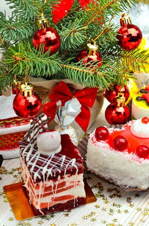 Christmas cakes on christmas background, christmas balls, pine twig.