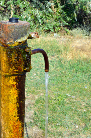 Old faucet for watering in wild nature.