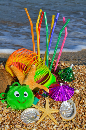Party decorations on the beach. Starfish, shells, candies, coconut, and tubules.