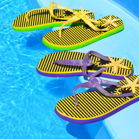 Flip-flops on the swimming pool.