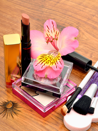 Cosmetics and orchid on wooden background, closeup Standard-Bild