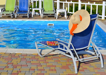 Chaise-longue and beach accessories near the pool.