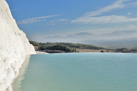 Natural travertine pools and terraces in Pamukkale. Cotton castle in southwestern