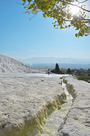 Travertine pools and terraces in Pamukkale, Turkey in a beautiful autumn day.