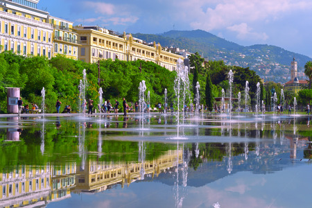 Cityscape with beautiful street fountain. Europe square in Nice.