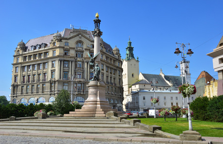 LVIV. UKRAINE - AUGUST 5, 2018: Adam Mickiewicz Square in Lviv on bright sunny day.