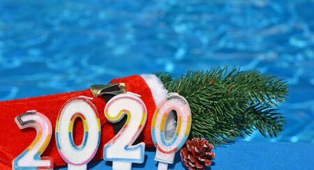 Christmas decorations and pine branch 2020, on the background of the pool. Stock Photo